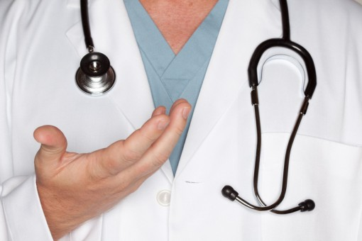 Male Doctor Hand Abstract with Lab Coat and Stethoscope.